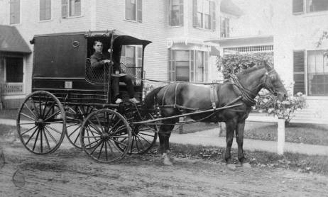 Sumner in delivery wagon